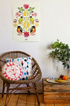 KID: Anny Who | swedish anthropoligie style house inspiratoin idea with tribal african geometrical pillow designs, wooden handmade chair and bright artwork with natural organic wood details