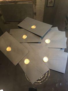 Golden wax seals on matt black envelopes.