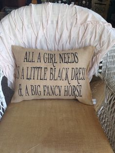 14x20 lumbar pillow covered in sultana burlap and stuffed with fiberfill.  The text, all a girl needs is a little black dress and a big fancy