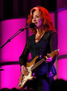 Bonnie Raitt. Let's give 'em something to talk about.....a little mystery to figure out...