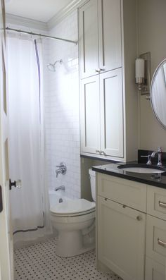 White and gray bathroom - storage above toilet