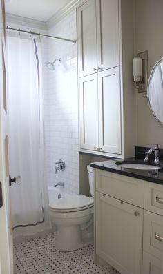 White and gray bathroom - storage above toilet