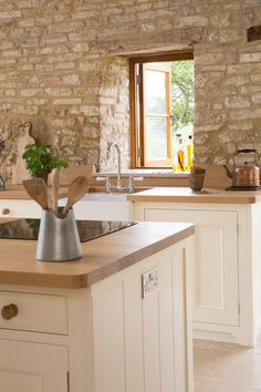 Farmhouse Kitchen - wow, what a great kitchen for this interior. It is well thought out and beautifully done.