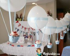 Hot Air Balloon Cupcakes: waaay to involved but it's a super cure idea! better for grownups than kids perhaps...