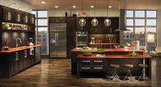 Gorgeous contemporary kitchen with dark brown cabinets and modern appliances. #KBHome