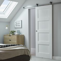 This sliding door system helps save space whilst adding a contemporary look to your home. Sliding door track system by Sliding Door Panels, Sliding Door Track, Sliding Wardrobe Doors, Loft Room, Bedroom Loft, Home Bedroom, Dispositions Chambre, Bedroom Built In Wardrobe, Loft Storage