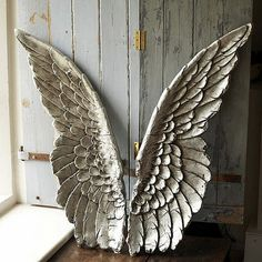 carved wooden wings...  just incredible.they may not be traditional shabby chic but whose to say what really is... my opinion? Perfect!