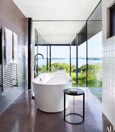 The minimalist master bath in architect Steve Mensch's Rhinebeck, New York, home makes the most of its Hudson River views | archdigest.com
