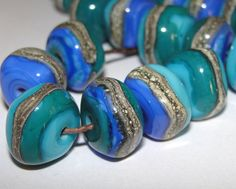 ~ NEPTUNE NUGGETS ~ Handfaceted organic nuggets in beautiful ocean hues wrapped with silvered ivory sands.    6 Beads  average 8x13mm  1/16th hole,