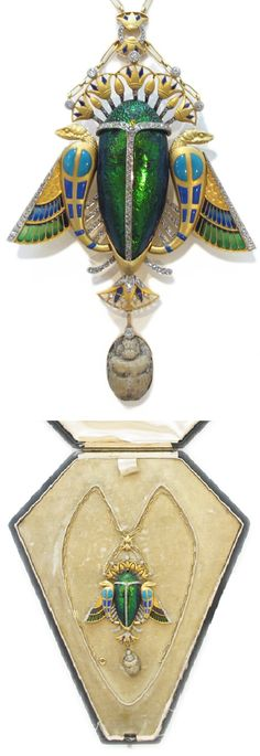 An important Egyptian Revival gold, scarab, enamel, diamond and lava stone necklace/brooch, circa 1900. With fitted case by Maison Auger. #EgyptianRevival #necklace #brooch