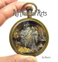 Travel themed pocket watch sculpture. Created by Sue Beatrice of All Natural Arts.
