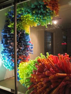 Anthropology Window Display; looks like swim noodles, great idea!