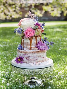 Gorgeous blooms add drama to this semi-naked cake from The Whimsical Cake Company www.thewhimsicalcakecompany.co.uk. As seen in Your Yorkshire Wedding issue 9. Image courtesy of www.eyecapture.co.uk