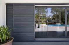 Find out all of the information about the PROFILS SYTEMES product: sliding shutter TAOS®. Contact a supplier or the parent company directly to get a quote or to find out a price or your closest point of sale. Exterior Blinds, Window Shutters Exterior, Interior And Exterior, Interior Paint, Sliding Door Panels, Door Design, House Design, Metal Shutters, Pole House