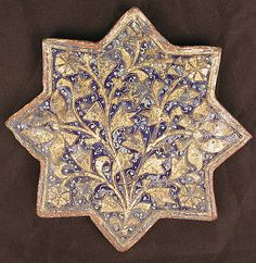 Three Tiles with 'Lajvardina' Glaze, stone paste; molded, overglaze, painted and leaf gilded. Iran. 1350-14th century