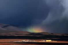 This rare rainbow appears over the Atacama Large Millimeter/submillimeter Array (ALMA) Operations Support Facility (OSF), which lies some 2900 metres above sea level close to San Pedro de Atacama. The OSF is the base camp for the ALMA site. This rainbow was captured by ESO employee Armin Silber.