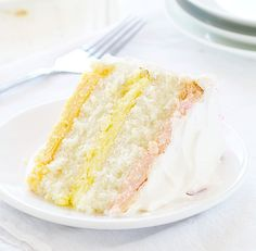 Awesome flavors and silky smooth texture make this cheesecake cake the BEST you will ever have! Reminiscent of spring, the colors are full of joy too!