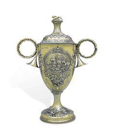 A GEORGE III SILVER-GILT TROPHY CUP, HESTER BATEMAN, LONDON, 1781.