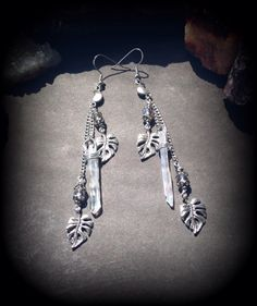 A beautiful handmade pair of earrings with antiqued silver crescent moon…