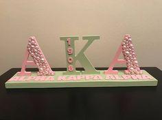Aka Sorority Gifts, Sorority Crafts, Sorority Letters, Diy Letters, Alpha Kappa Alpha Sorority, Sorority And Fraternity, Wooden Greek Letters, Alpha Kappa Alpha Paraphernalia, Pretty In Pink