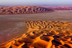 Ancient Sea - I photographed this unusual sight in the Empty Quarter, world's largest and most inhospitable sand desert. These vast plains are known as 'Sabhkas'; a compacted sand hardened by thousands of years of relentless wind mixed with salty deposits.  These are the remains of the ocean that used to cover the Arabian peninsula during the last Ice Age, approx 15,000 - 10,000 years ago.  These colossal dunes, hundreds of meters tall been traveling aimlessly across these plains ever sin...