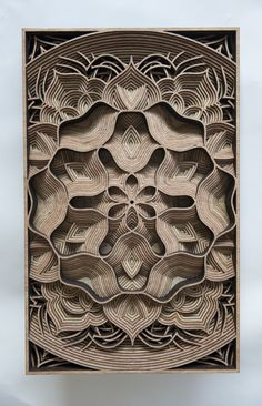 Gabriel Schama's Mandala-Like Paper and Laser-Cut Wood Relief Sculptures | Hi-Fructose Magazine