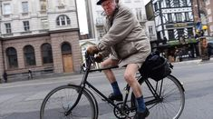 FORGOT ANYTHING? An elderly man cycled in his shorts Wednesday along Fleet Street in central London, where the high reached 52 degrees Fahre. Today Pictures, Fleet Street, Elderly Man, Hood Ornaments, Cycling, Bicycle, Urban, Coat, Wednesday