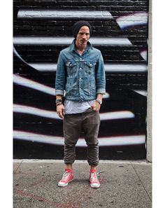 Denim jacket + white longline t-shirt + relaxed chinos + sneakers