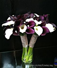 December wedding bouquet! www.colonialflowers.org calla lillies
