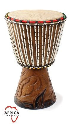 African D'Jembe Drum - Hand carved wooden base and colorful rope. This traditional African drum is a perfect gift for the drum lover in your life. Each drum is hand made by African artisans, so no two drums are alike!