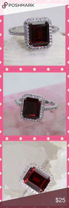 4Ct. Italian Royal Red Zircon w/42 White Zircon The 4Ct. Red Zircon is rated 5AAAAA level and the White Zircon are a 3AAA level making this a very quality and beautiful ring. It is a Size 7. It has three times the normal Platinum plating. Jewelry Rings