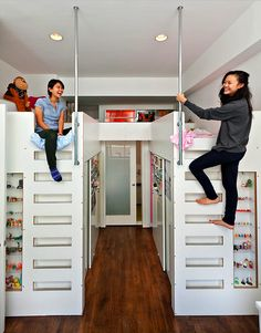 """Very cool bunk beds/storage.  It looks like there may be closet space under the beds.  And I love the little """"night stand"""" area between the heads of the beds - above the door."""