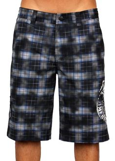 da7a003633 Affliction Phelan mens knee length shorts features a bold black and grey  plaid print all over the front and back with a large winged skull insignia  and ...