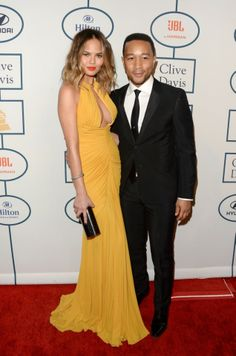 56th Grammy Awards – What the Celebrities Wore. John Legend and his wife.