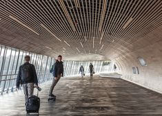 Completed in 2019 in Køge, Denmark. Images by Rasmus Hjortshøj – COAST. Køge Nord Station was officially opened by Crown Prince Frederik at an event on May The event marked the opening of the new gateway to. Sustainable Transport, Transport Hub, Aluminium Cladding, Us Swimming, Bridge Design, Travel Route, Pedestrian Bridge, Construction, Futuristic Design