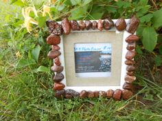 "this adorable ""shadow box"" look alike, 3x3 photo frame,is adorned with all red toned rock."