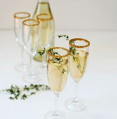 Champagne with gold sprinkle rims! Perfect for New Years, St Patrick's Day, or a Birthday Party! #cocktails #recipe