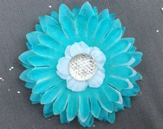 This mini flower hair clip is perfect for a simple wedding updo, a flower girl, to add sparkle to any outfit, or a babys headband. About this flower hair clip: -The flower measures about 2 1/2 in diameter -Weighs less than half an ounce -The flower is made with layers of fabric petals -Has an alligator clip on the back -The alligator clip is 1 1/4 ~The clip is partially covered by a strip of felt to maintain proper grip FREE SHIPPING! Please note, this only applies to US addresses. ...