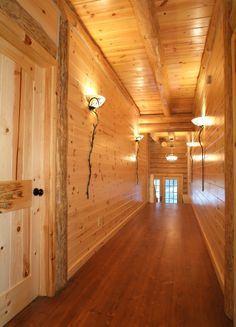 Tongue & Groove Knotty Pine Paneling with Log Ceiling Joists