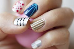 Love all of the different patterns on the nails...but if I did them, I'd only do one pattern at a time...not mixed up!