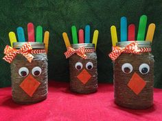 Thanksgiving Mason Jar Craft. Brown thread, Orange Felt, Ribbon, Googly Eyes, Colored Popsicle Sticks. Fill with desired candy and voila! Perfect gift for teachers and coworkers!