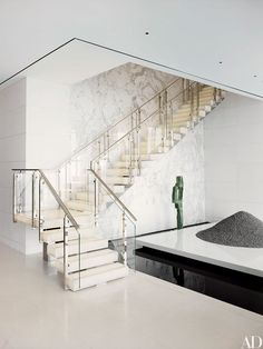 A Manhattan penthouse by ODA-Architecture features a glowing white-onyx staircase | archdigest.com