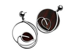 SILVER EARRINGS ONE WITH A WOODEN LEAF AND THE OTHER WITH A WOODEN CIRCLE AND A LEAF ON TOP