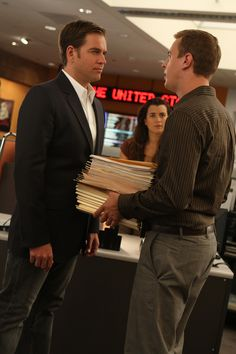 "Tony and McGee arguing over who has to do the paperwork! I love Ziva's face in the back. She's like ""What?"". Hee hee!"