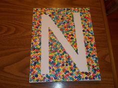 Create your letter with painter's tape and then go to town with a Q-tip and paint!