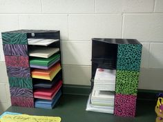Magazine holders on their side and stacked on top of one another