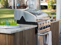 Create an outdoor kitchen by nestling a gas grill into a custom-built, granite-topped island. From the experts at DIYNetwork.com. Cool Kitchens, High End Kitchens, Kitchen Grill, Kitchen Appliances, Check, Built In Outdoor Grill, Build Outdoor Kitchen, Built In Grill, Weber Grills