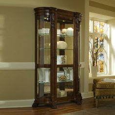 102003 Curio with Beveled Glass Door Mirrored Back Decorative Carvings and Halogen Lighting in Foxcroft Finish, Brown Pulaski Furniture, Home Furniture, Davis Furniture, Furniture Stores, Furniture Ideas, Corner Curio, Curved Glass, Beveled Glass, Antiques