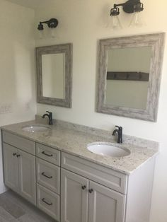 This couples bathroom features double sinks and a large custom vanity with rustic mirrors and lighting. Farmhouse Bathroom Mirrors, Rustic Mirrors, Master Bathroom, Couples Bathroom, Bathroom Ideas, Johnson House, Parents Room, Double Sinks, Custom Vanity