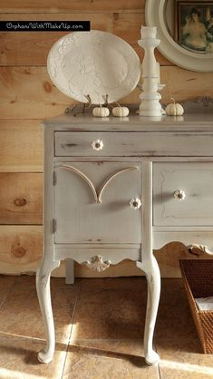 A gorgeous Queen Anne sideboard finished in Paris Grey Chalk Paint® decorative paint by Annie Sloan and Soft Wax | By Orphans with MakeUp